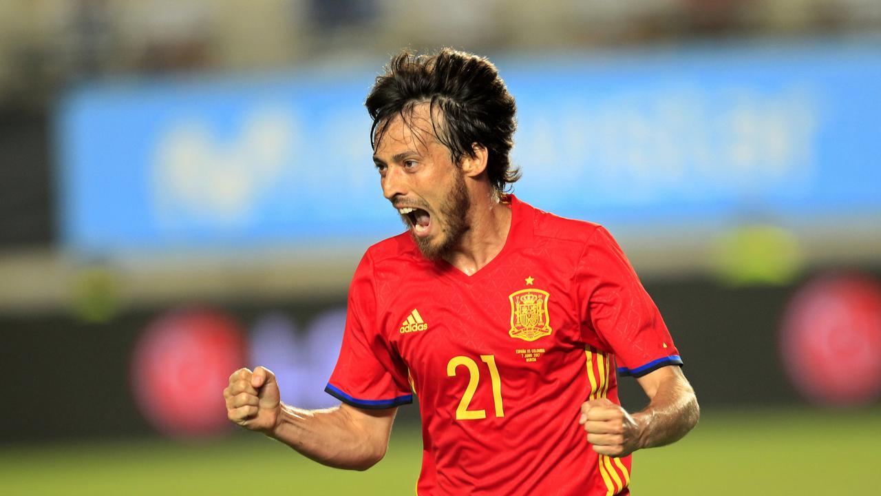Spain's David Silva celebrates after scoring