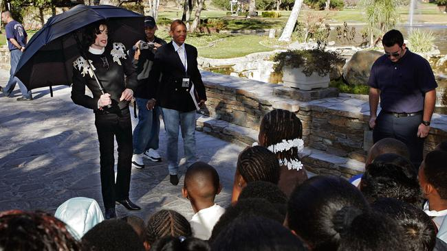 Michael Jackson greets several hundred children that were invited guests at his Neverland Ranch home in 2004.