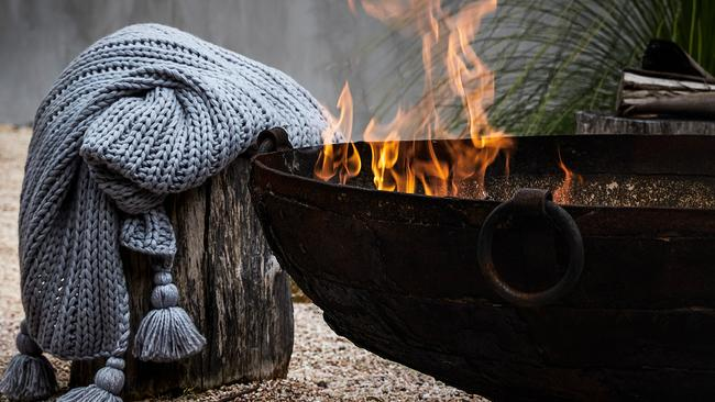 Grab a Zinc Piper throw from Adairs and head outdoors to a cosy fire pit.