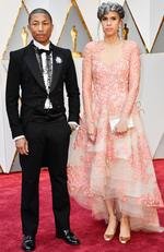 Producers Pharrell Williams (L) and Mimi Valdes attend the 89th Annual Academy Awards. Picture: Frazer Harrison/Getty Images