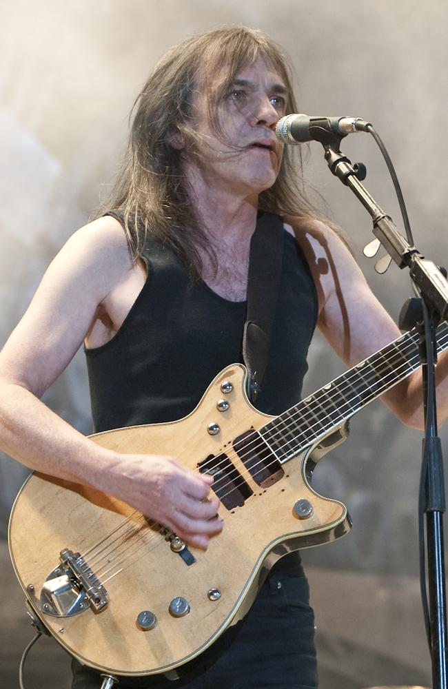 Health battles ... Malcolm Young, pictured during AC/DC's Black Ice tour, is in hospital. Picture: Charles Brewer