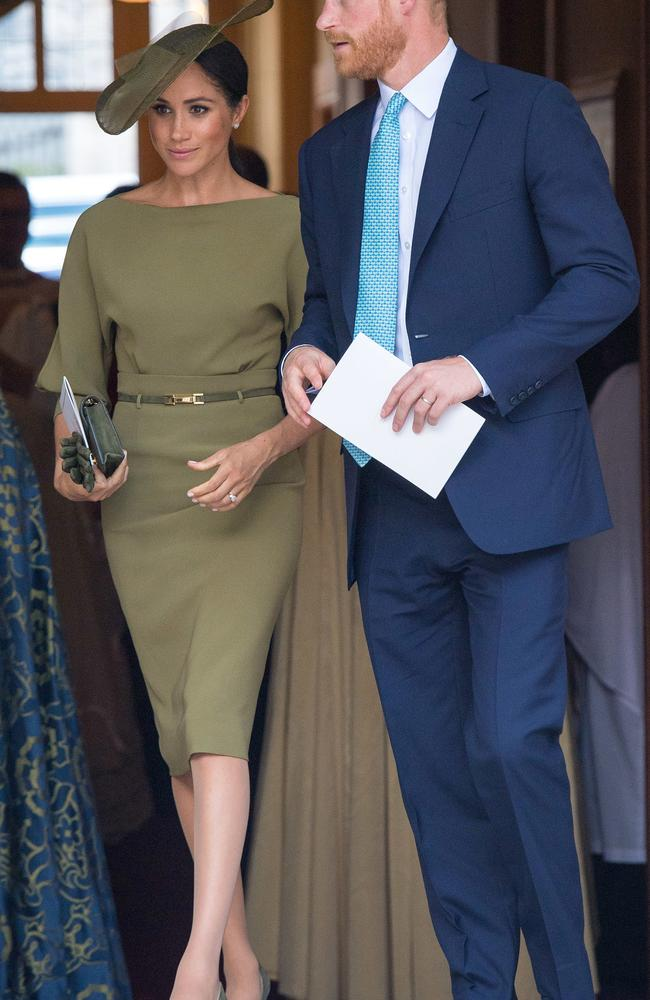 Meghan attends Prince Louis' christening in an olive green frock. Picture: Mega