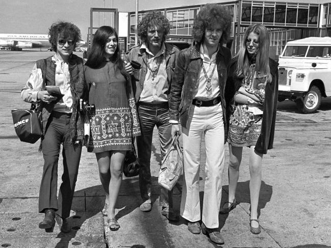 Cream depart from Heathrow Airport in London, for their American tour in 1967. The trio, walking with unidentified female companions, from left are, base guitarist Jack Bruce, drummer Ginger Baker, and lead guitarist Eric Clapton. Picture: AP