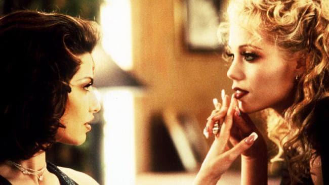 Gina Gershon (left) and Elizabeth Berkley (right) admiring one another's nails in Showgirls. Nails are a big thing in Showgirls.
