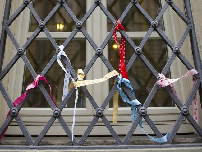 Ribbons are tied to window grates at Domus Australia, where Cardinal George Pell usually gives mass. Picture: David Mirzoeff/i-Images