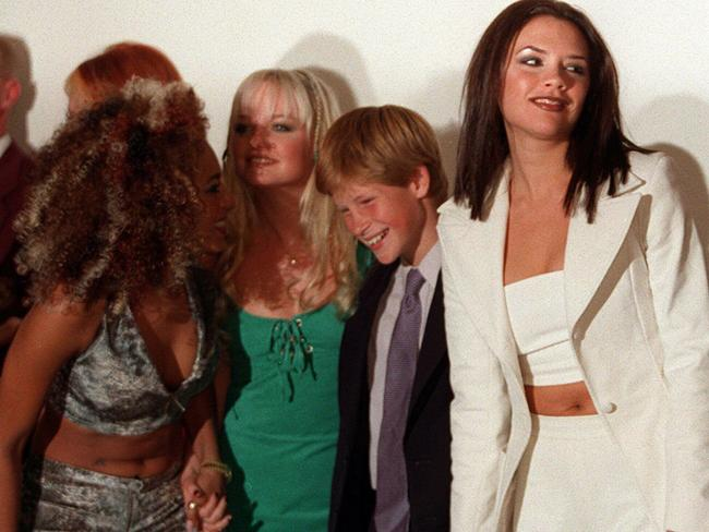 A grinning Prince Harry with the Spice Girls in 1997. Picture: Supplied