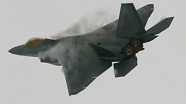 "A United States Air Force F22 ""Raptor"" fighter manoeuvres. A detachment of the advanced stealth fighter aircraft has been deployed to South Korea."