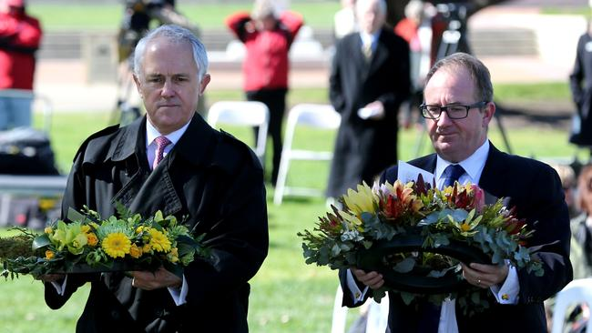 Paying tribute ... PM Malcolm Turnbull and David Feeney, representing the leader of the Opposition, lay wreaths at the dedication of the War Correspondents Memorial.