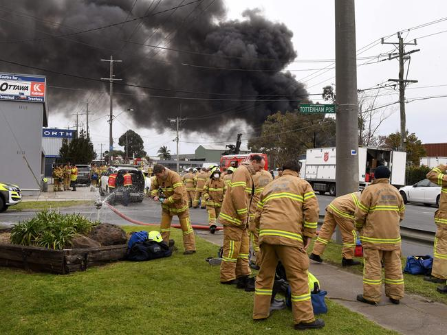 Firefighters prepare to battle the giant factory fire. Picture: William West/AFP