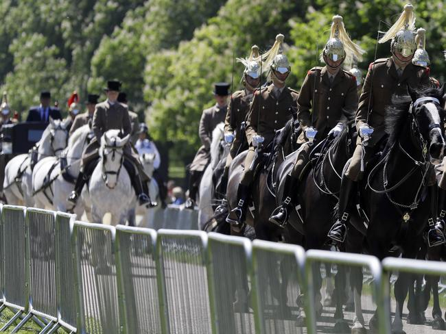 A carriage procession drives along The Long Walk during a rehearsal for The Royal Wedding in Windsor, England.