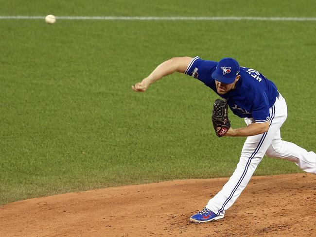 Liam Hendriks throws a pitch in the third inning against the Kansas City Royals.