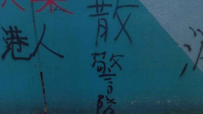 "Graffiti that reads ""Dismiss Police Force"". Picture: Billy H.C. Kwok/Getty Images."