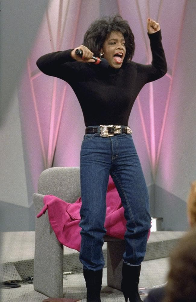 Oprah shows off a teeny-tiny waist. Picture: AP Photo/Charles Bennett