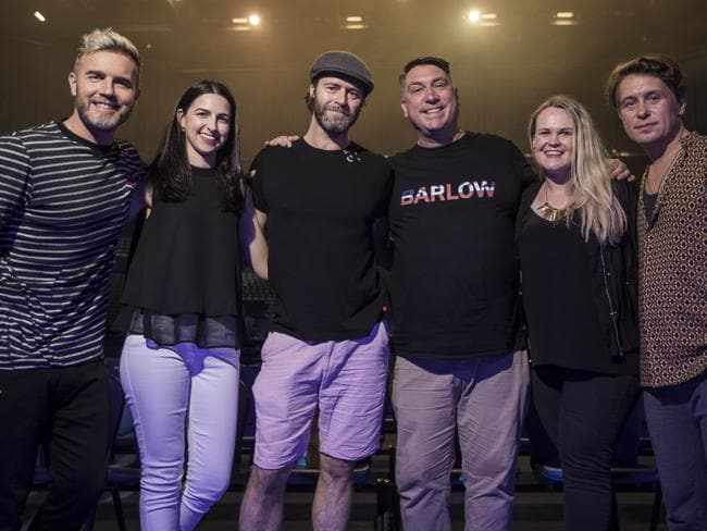 Take That with fans Jasmine Crowsley, Tony Hamlyn and Mel Reed. Photo by Michael Wilson, The West Australian.