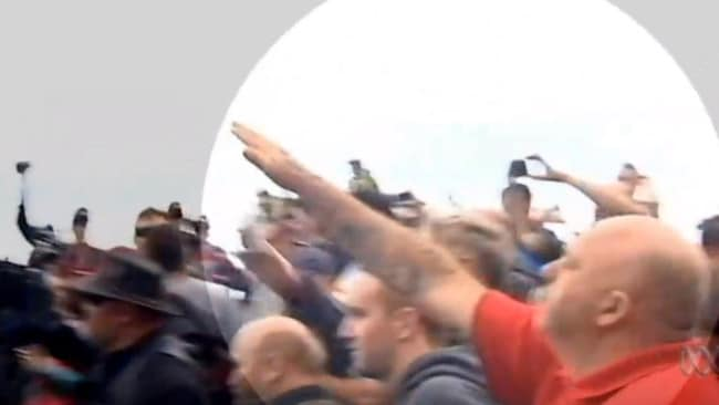 A man throws his arm up in a Nazi salute at St Kilda. Picture: ABC News