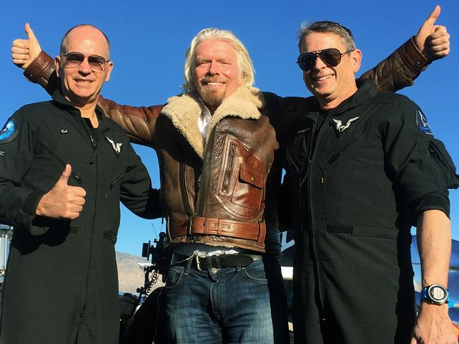 Richard Branson centre celebrates with pilots Rick Sturckow, left, and Mark Forgera Stucky, right, after Virgin Galactica's tourism spaceship climbed more than 80 kilometres high above California's Mojave Desert. Picture: AP