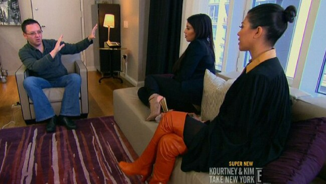 John Edward gives a reading for Kim and Khloe in 2012. Image: E!