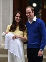 Britain's Prince William, Duke of Cambridge, and his wife Catherine, Duchess of Cambridge show their newly-born daughter, their second child, to the media outside the Lindo Wing at St Mary's Hospital in central London, on May 2, 2015. The Duchess of Cambridge was safely delivered of a daughter weighing 8lbs 3oz, Kensington Palace announced. The newly-born Princess of Cambridge is fourth in line to the British throne. AFP PHOTO / LEON NEAL