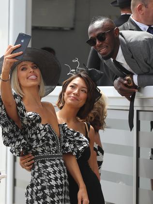 Bolt poses with fans. Picture: Alex Coppel