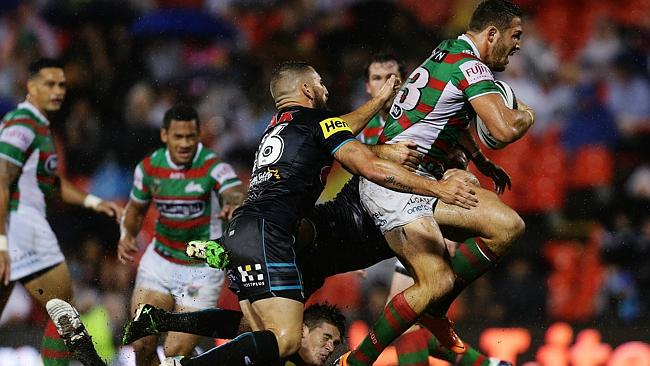 South Sydney's Sam Burgess is tackled by the Panthers defence.