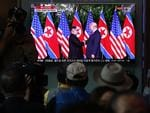 South Koreans watch on a screen reporting on the U.S. President Trump meeting with North Korean leader Kim Jong-un at the Seoul Railway Station on June 12, 2018 in Seoul, South Korea. Picture: Chung Sung-Jun/Getty Images