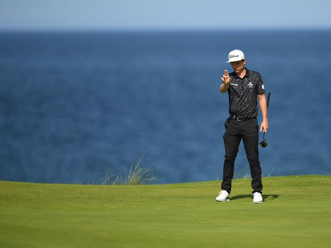 Australia's Cameron Smith prepares to putt at the 5th green. Picture: Glyn Kirk/AFP