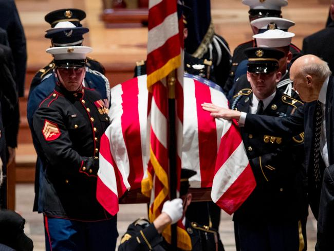 George H.W. Bush's coffin is carried from the Washington Cathedral after his funeral service. Picture: AFP