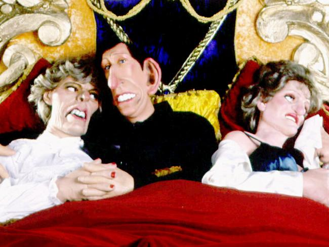 A scene from satirical 80s TV show Spitting Image featuring latex puppets of Prince Charles embracing then mistress Camilla Parker Bowles in bed with Princess Diana. Picture: Supplied