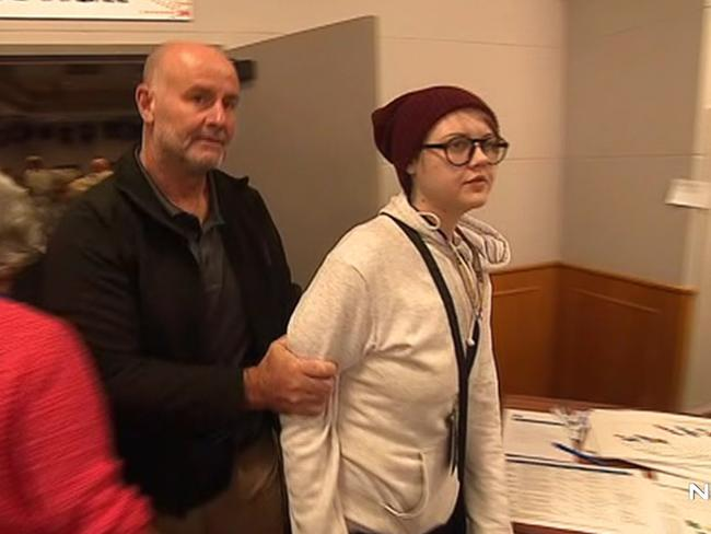 She was quickly detained by security. Picture: Seven News