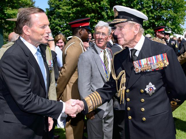 Tony Abbott greets Prince Philip in France last year. Picture: AFP Photo/Leon Neal