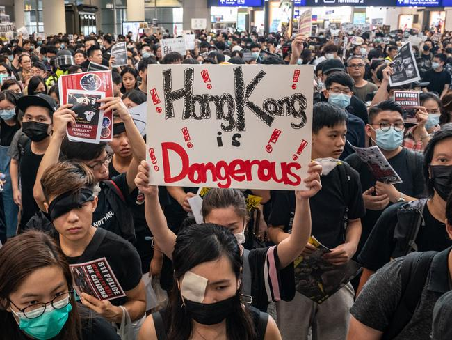 Protesters occupy the arrival hall of the Hong Kong International Airport during a demonstration on August 12, 2019 in Hong Kong, China. Picture: Getty Images