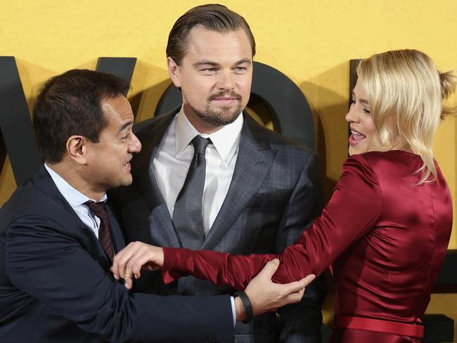 The US is also investigating Jho Low's friend, Wolf of Wall Street producer Riza Aziz (left) who is pictured here with actors Leonardo DiCaprio and Margot Robbie. Picture: Paul Hackett.