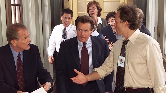 West Wing cast John Spencer as chief of staff Leo McGarry, Rob Lowe as deputy communications director Sam Seaborn, Martin Sheen as President Josiah Bartlet, Allison Janney as press secretary C.J. Cregg, Moira Kelly as political consultant Madeline Hampton and Bradley Whitford as deputy chief of staff John Lyman. Picture: NBC