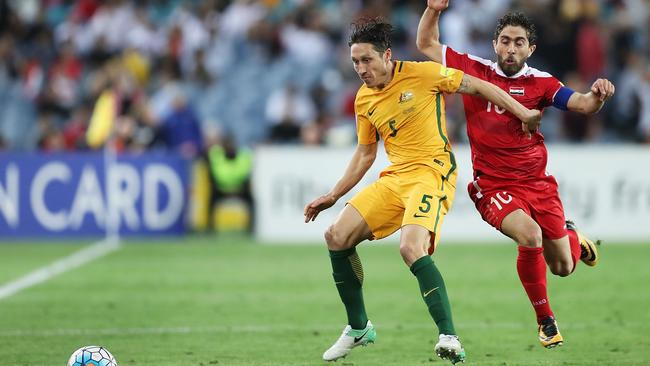 Mark Milligan competes for the ball against Syria on Tuesday night. Picture: Getty Images