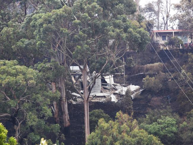 Houses that have been lost in bushfires at Separation Creek on the Great Ocean Road in Victoria. Saturday, Dec 26. 2015. Picture: David Crosling