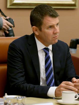 NSW Premier Mike Baird listens to Malcolm Turnbull.