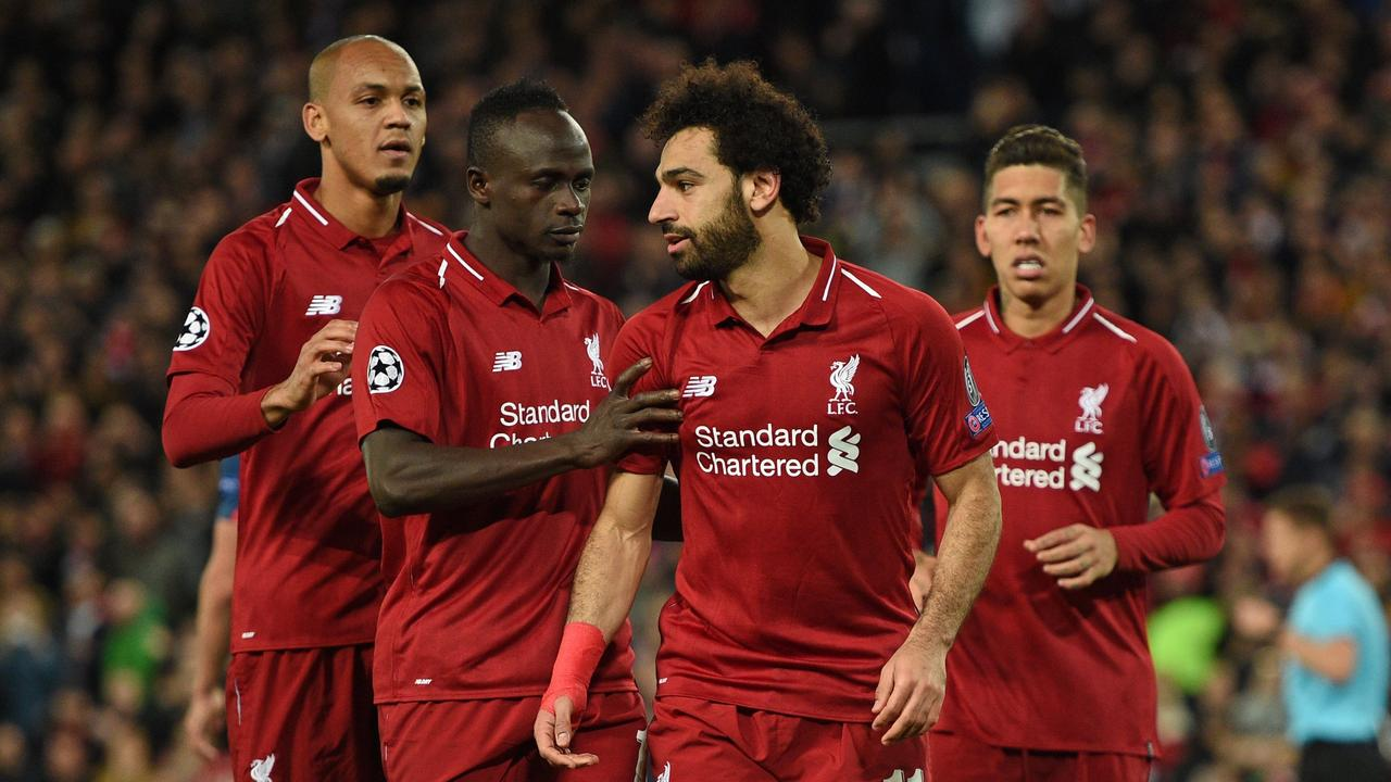 Liverpool's Egyptian midfielder Mohamed Salah (2nd R) celebrates with Sadio Mane (2nd L) and Fabinho (L)