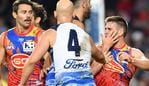 Gary Ablett (centre) of the Cats is seen scuffling with Anthony Miles (right) of the Suns during the Round 10 AFL match between the Gold Coast Suns and the Geelong Cats at Metricon Stadium on the Gold Coast, Saturday, May 25, 2019. (AAP Image/Darren England) NO ARCHIVING, EDITORIAL USE ONLY