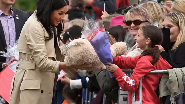 The Duchess of Sussex greets children on a public walk in Melbourne. Picture: William West.