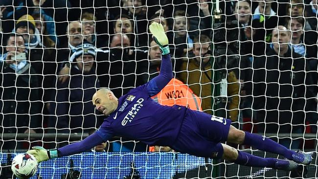 Manchester CIty's Argentinian goalkeeper Willy Caballero (L) saves.