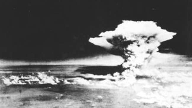 The mushroom cloud over Hiroshima after Enola Gay drops the atomic bomb.