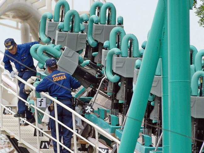 Police examine the rollercoaster at Osaka's Expoland amusement park on May 5, 2007. Picture: Jiji Press/AFP