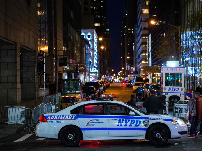 Night in the city ... and the NYPD is on the job. Picture: AFP
