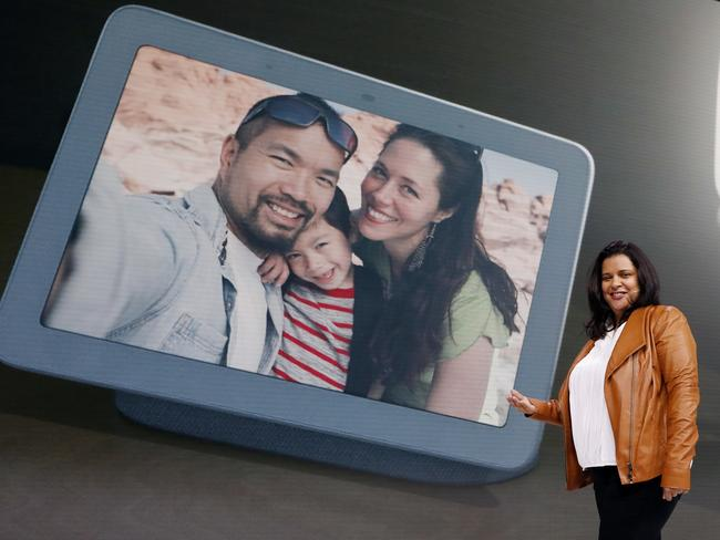 Diya Jolly, Google's vice-president of product management, shows off the happy family times you can have on the Home Hub. Picture: Richard Drew