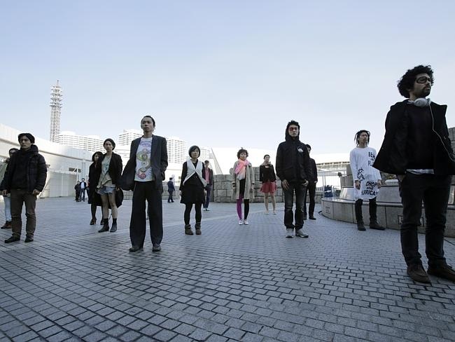 Demonstrators participate in a silence protest in front of a conference hall where the Intergovernmental Panel on Climate Change met near Tokyo. Picture: AP