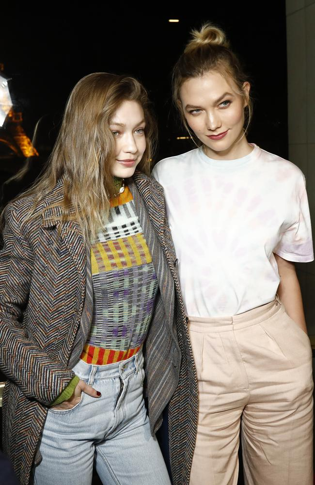 Gigi Hadid, pictured with Karlie Kloss, has been out and about in Paris where she also attend the launch of Evian and Virgil Abloh's limited-edition One Drop collection. Picture: Getty Images