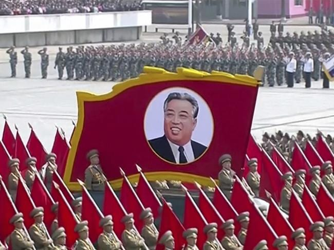 A portrait of the country's founder Kim Il Sung is carried during the parade.