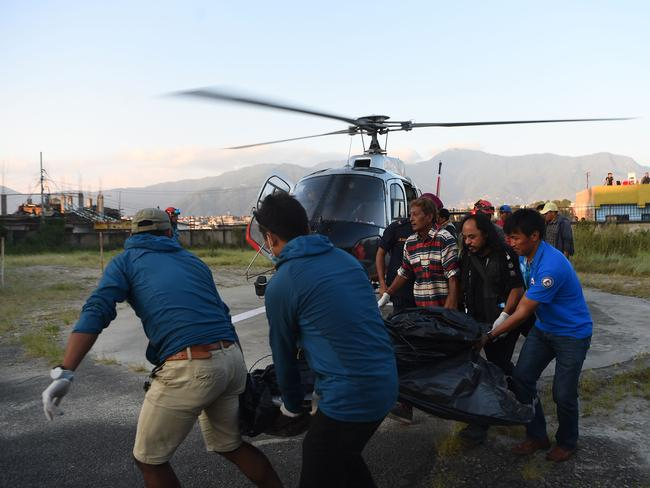 Emergency services recover the bodies of the nine climbers who died in Nepal. Picture: AFP