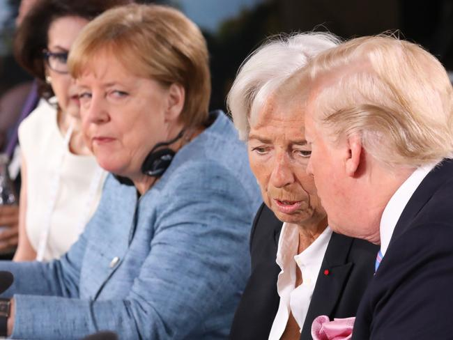 Angela Merkel appears uniimpressed as Donald Trump discusses gender equallity with IMF managing director Christine Lagarde during the G7 Summit.
