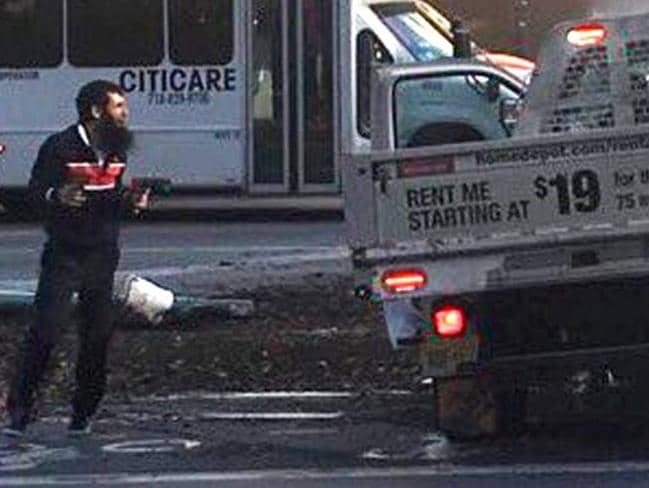 This chilling image shows Sayfullo Saipov pictured at the scene of the terror attack before his arrest.